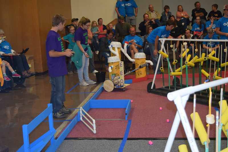Peetz E.I.E.I.O. team members get their robot into position to be filled with corn seeds during the Golden Plains BEST Robotics Challenge Saturday, Oct. 29, 2016.
