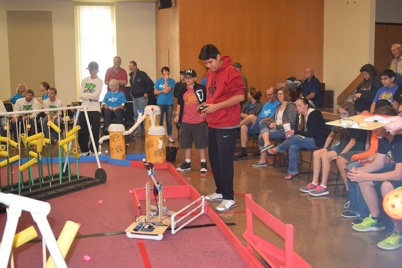Holyoke Junior and Senior High School team members guide their robot out of the corral during the Golden Plains BEST Robotics Challenge Saturday, Oct. 29, 2016.