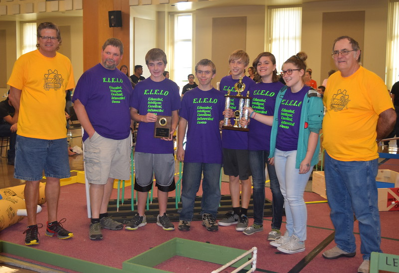 Larry Turner, left, hub director, and Mike Sullivan, right, assistant hub director, present the first place trophy for the Golden Plains BEST Robotics Challenge to the E.I.E.I.O Peetz team, coached by Brian Kurz, Saturday, Oct. 29, 2016. Team members include Owen Kurz, Dani Albus, Lydia Travis, Charles Fehringer and Matthew Davis.