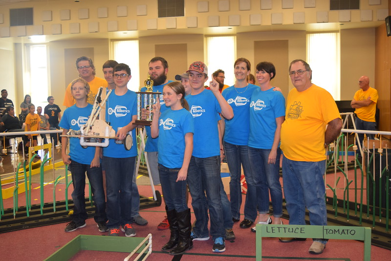 Larry Turner, back row right, hub director, and Mike Sullivan, back row left, assistant hub director, present the first place trophy for the Golden Plains BEST Robotics Challenge to the team from Otis School and their coach, Jennifer Willeke, Saturday, Oct. 29, 2016. Team members include Ian Halcomb, Kris Jones, Kylie Jones, Gunnar Tribelhorn, Jack Wilkie and Aiden Blackwell.