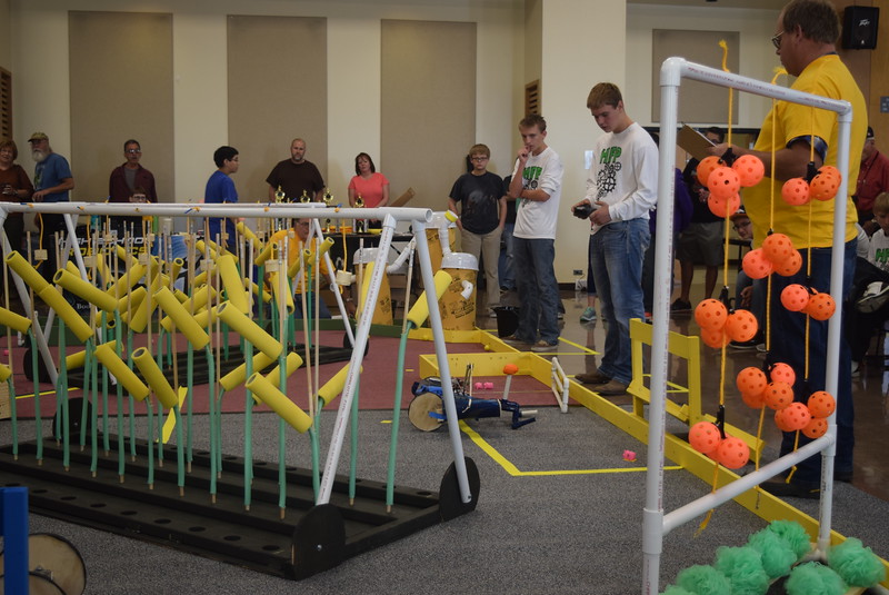 Julesburg Junior and Senior High School team members work to corral pigs during the Golden Plains BEST Robotics Challenge Saturday, Oct. 29, 2016.