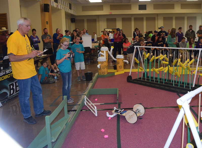 Peetz Robodogs team members work to corral pigs with their robot during the Golden Plains BEST Robotics Challenge Saturday, Oct. 29, 2016.