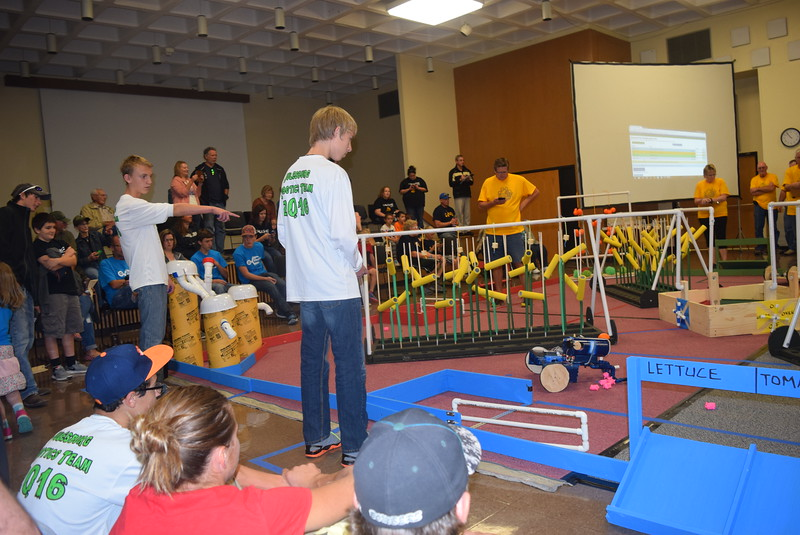 Julesburg Junior and Senior High School team members work to corral pigs with their robot during the Golden Plains BEST Robotics Challenge Saturday, Oct. 29, 2016.