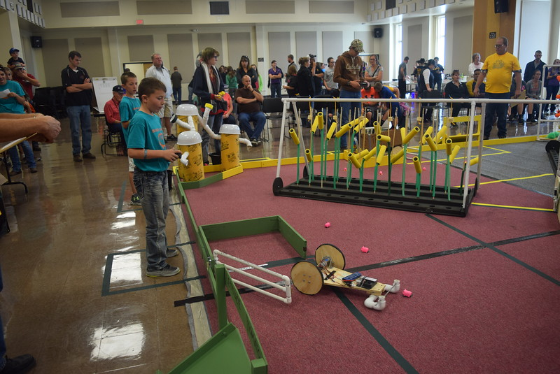 Peetz Robodogs team members guide their robot out of the corral and work to corral pigs spread across the playing field during the Golden Plains BEST Robotics Challenge Saturday, Oct. 29, 2016.