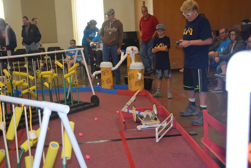 Peetz Cybermen team members guide their robot out of the corral during the Golden Plains BEST Robotics Challenge Saturday, Oct. 29, 2016.