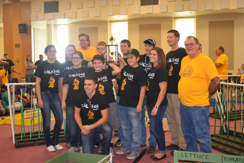 Larry Turner, back row right, hub director, and Mike Sullivan, back row left, assistant hub director, present the third place trophy for the Golden Plains BEST Robotics Challenge to the Caliche Jr./Sr. High School team and their coaches, David Monheiser and Kelsey Yearick. Team members include Ross Skeels, Houston Hernandez, Brooke Stromberger, Alexa Hernandez, Brayden Lawson, Kristofer Meraz, Andrea Marick, Kyser Martinez and Nevada Mitchell.