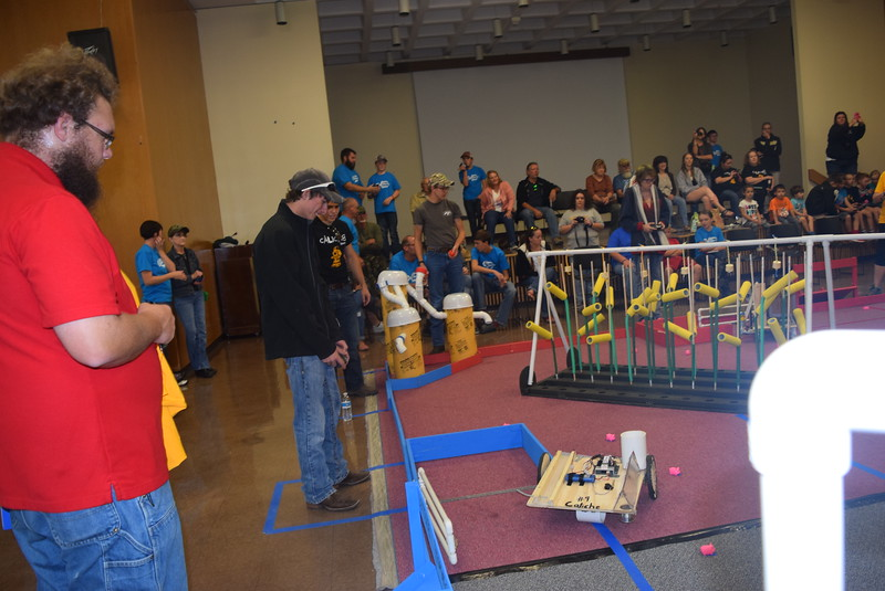 Caliche Junior and Senior High School team members work to corral pigs during the Golden Plains BEST Robotics Challenge Saturday, Oct. 29, 2016.
