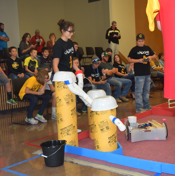 Caliche Junior and Senior High School team members work to load their robot with corn seeds during the Golden Plains BEST Robotics Challenge Saturday, Oct. 29, 2016.