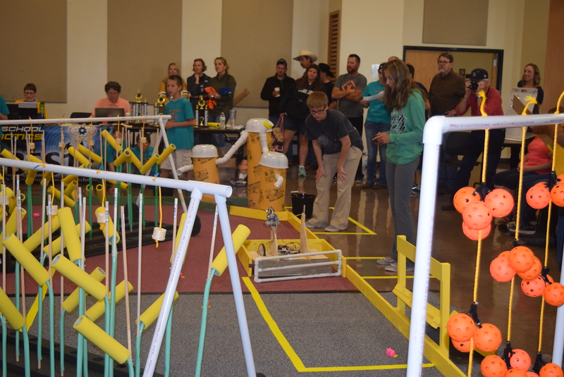 Revere Junior and Senior High School team members work to get the gate open with their robot during the Golden Plains BEST Robotics Challenge Saturday, Oct. 29, 2016.