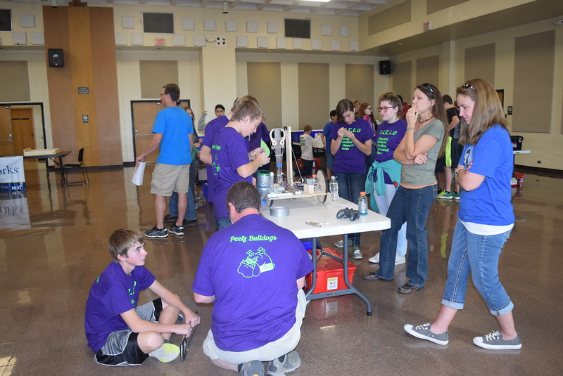 Peetz E.I.E.I.O team members work on some adjustments to their robot during a break between matches at the Golden Plains BEST Robotics Challenge Saturday, Oct. 29, 2016.