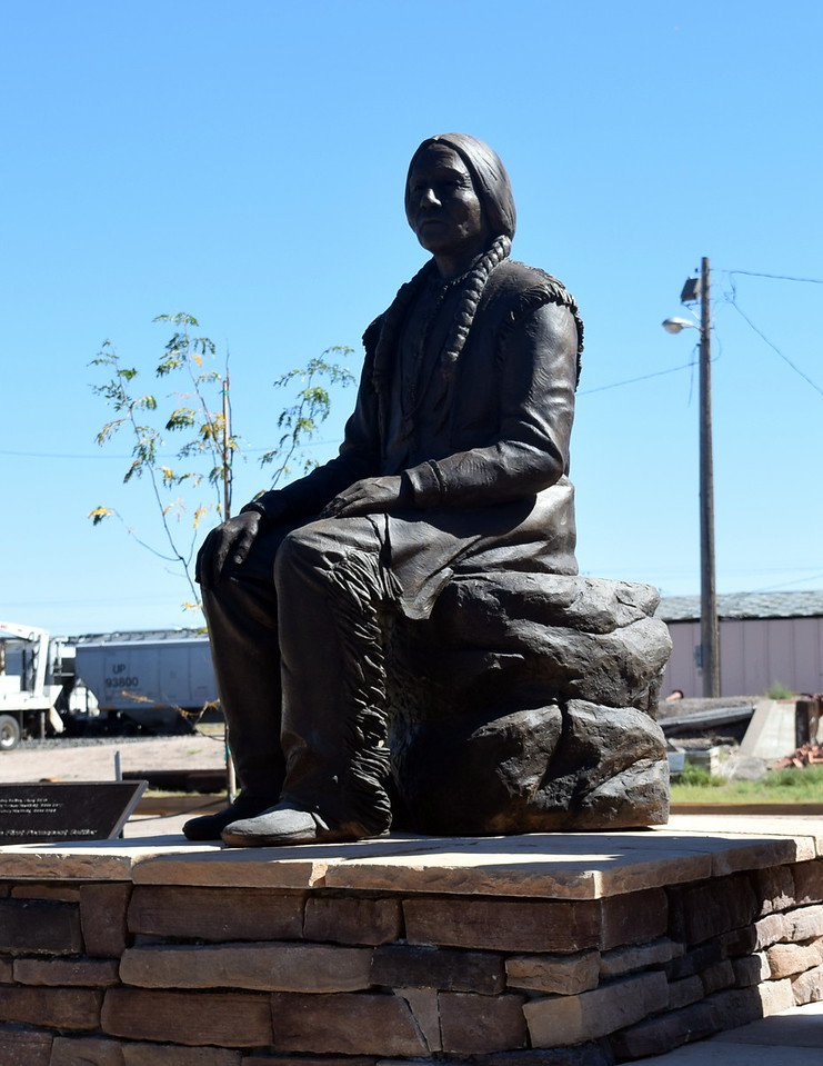 "A contemporary of Hadfield's - a prairie Indian sits nearby the William ""Uncle Billy"" Hadfield and ""Aunt"" Charity Sanders Hadfield sculpture."