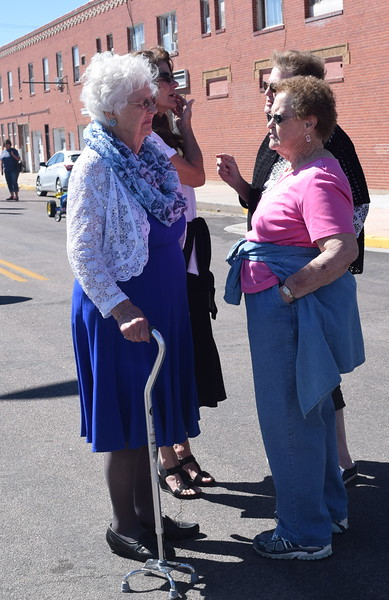 Jenevieve Sanders Manuello DeSoto, a descendent of Charity Hadfield, visits with guests at the unveiling of the Hadfield sculpture Saturday, Sept. 24, 2016.