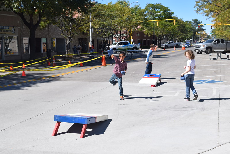A corn hole game was part of the fun for children at the unveiling of the Hadfield bronze sculpture Saturday, Sept. 24, 2016.