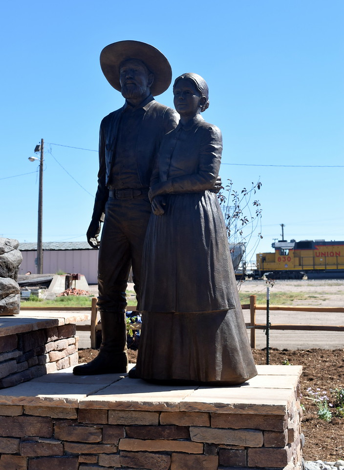 "A bronze sculpture depecting William ""Uncle Billy"" Hadfield and ""Aunt"" Charity Sanders Hadfield looks out towards downtown Sterling."