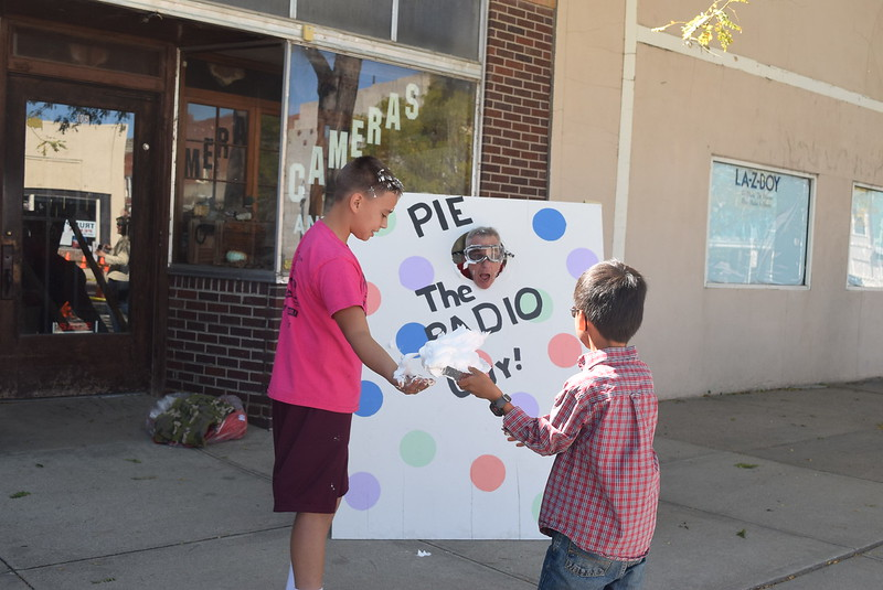 "Andy Rice, KPMX radio host, prepares to get a pie to the face at the ""Pie the Radio Guy"" booth Saturday, Sept. 24, 2016, at the sculpture unveiling. Money raised from those who purchased a pie to throw was donated to Sterling Police Department."