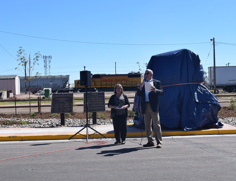 Don Saling, representing the Sterling Rotary and Reviewers Clubs' Art Committee, gives remark prior to the unveiling of Sterling's newest bronze sculpture. Joining him is Kim Jackson, president of the Sterling Reviewers Club, who also gave remarks.