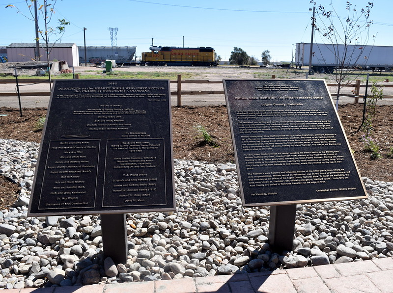"Plaques next to the Hadfield bronze sculpture provide historical information about the Hadfields, as well as information about the descendents of ""Aunt"" Charity Sanders Hadfield and the donors to the sculpture project."