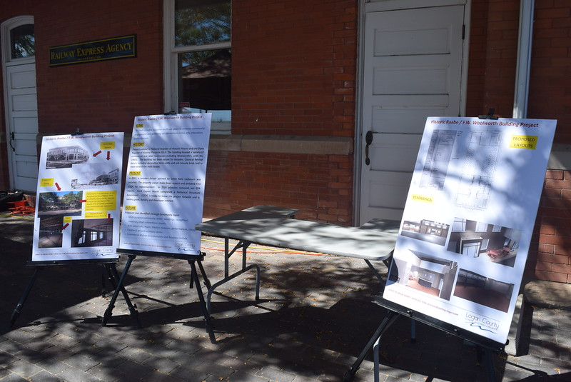 Logan County Economic Development Corporation had information about the Woolworth Building and photos of potential layouts on display at the unveiling of Sterling's newest bronze sculpture Saturday, Sept. 24, 2016. The organization was encouraging people to vote in favor of the convention center tax in the November election, to fund a possible renovation of the building.