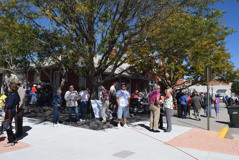 Guests mingle as they wait for the unveiling of Sterling's newest bronze sculpture Saturday, Sept. 24, 2016.