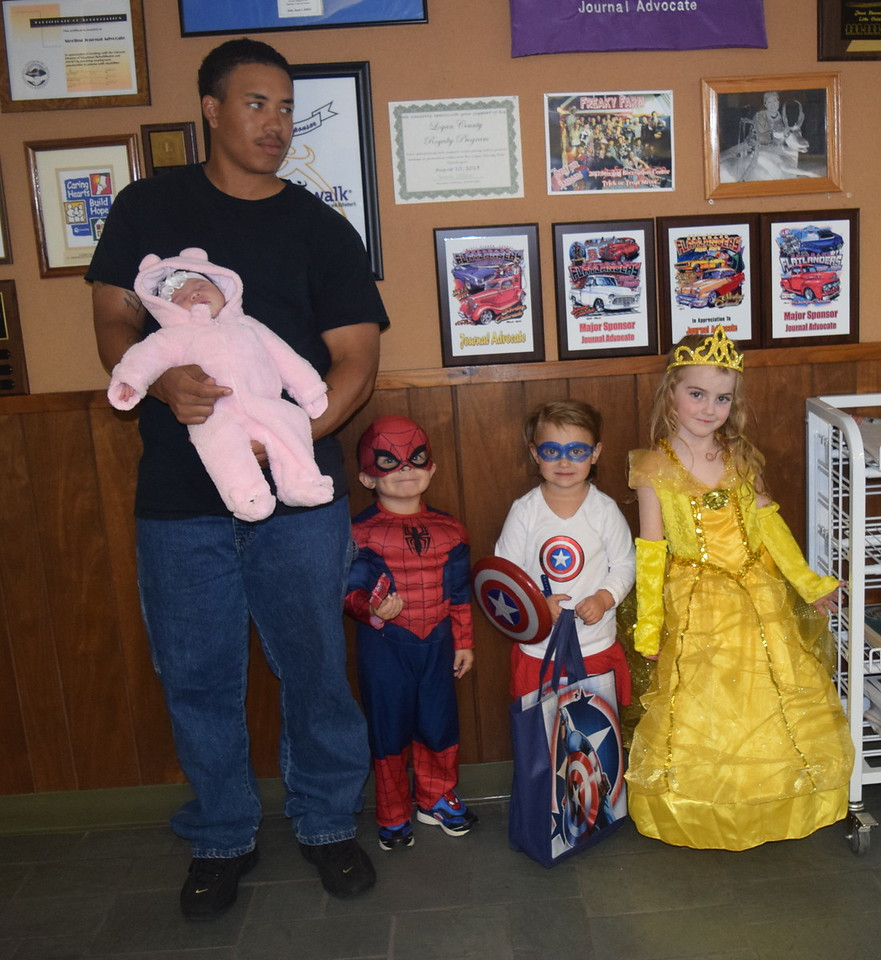 From left; Sophia Baca, 3 weeks, dressed as a bear; Julian Baca, age 3, dressed as Spiderman; Noelle Renner, age 3, dressed as Captain America; and Bray Lynne Gower, age 4, dressed as Belle, were among the trick-or-treaters that stopped by the Journal-Advocate on Halloween, Monday, Oct. 31, 2016