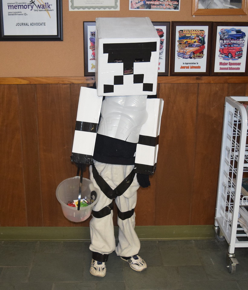 Derek Mclinn, age 8, was well hidden in his Star Wars Stormtrooper costume when he visited the Journal-Advocate Monday, Oct. 31, 2016, for some Halloween candy.