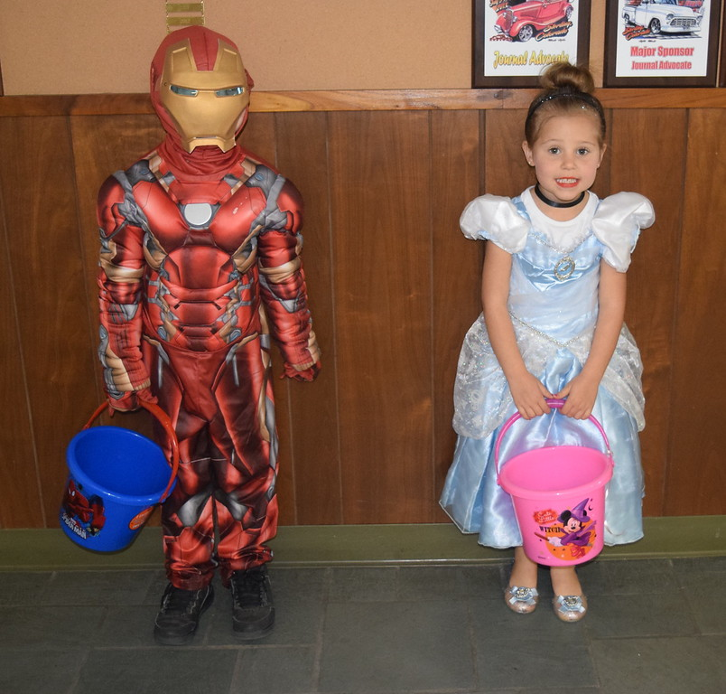 Anothony DeMaria, age 6, dressed as Iron Man, and Mya DeMaria, age 4, dressed as Cinderella, were among the trick-or-treaters that visited the Journal-Advocate Monday, Oct. 31, 2016, for some Halloween candy.