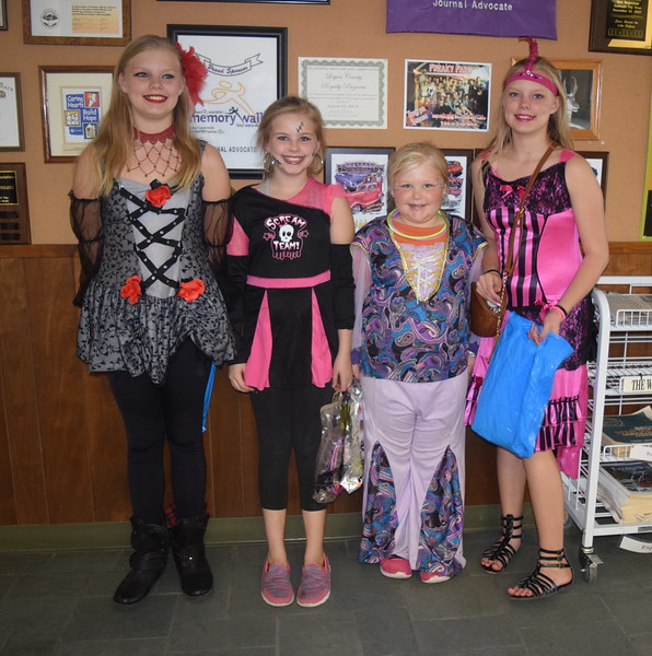 From left; Trinity Collins, age 12, dressed as an evil fairy; Kayla Collins, age 10, dressed as a Dead Cheerleader;Skyler Collins, age 8, dressed as a genie; and Destiny Collins, age 12, dressed as a saloon girl, were among the trick-or-treaters that stopped by the Journal-Advocate for some Halloween treats Monday, Oct. 31, 2016.