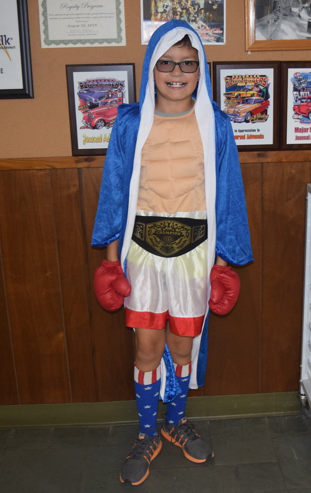 Caleb Garcia, age 9, dressed as a boxer, was ready for a fight when he stopped by the Journal-Advocate for some Halloween treats Monday, Oct. 31, 2016.