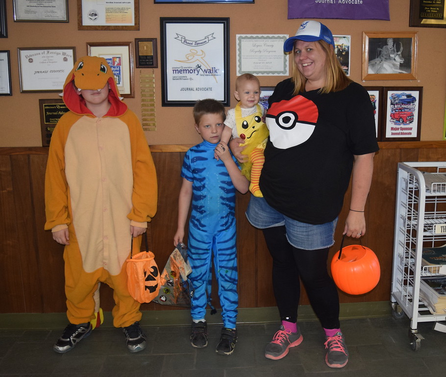 These trick-or-treaters were looking to catch some Pokemon when they stopped by the Journal-Advocate Monday, Oct. 31, 2016, for some Halloween treats. From left; Josh Emrick, age 10, dressed as Charmander; Connor Emrick, age 7, dressed as a Pokemon; and Lizzie Flint, age 6 months, dressed as Pikachu.