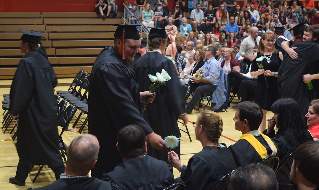 . Graduates present followers to their family and friends during Haxtun High School\'s commencement ceremony Sunday, May 14, 2017.