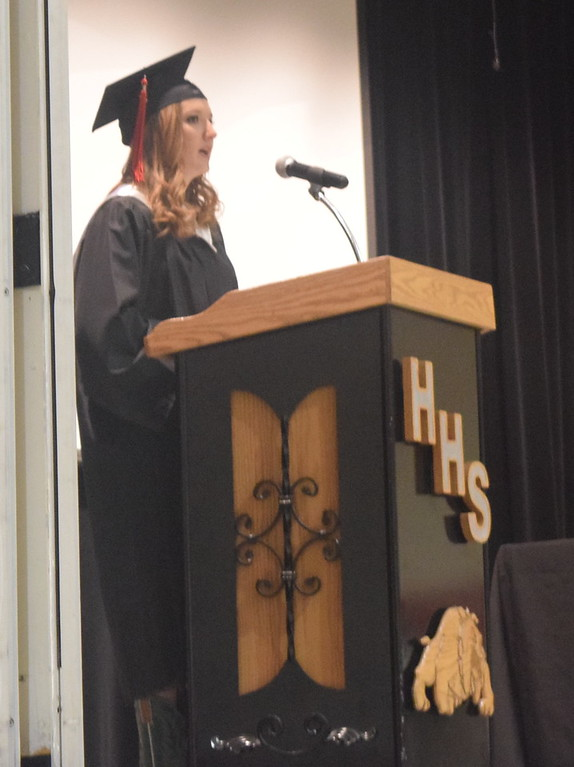 . Class treasurer Brittany Fetzer presents the class gift at Haxtun High School\'s commencement ceremony Sunday, May 14, 2017.