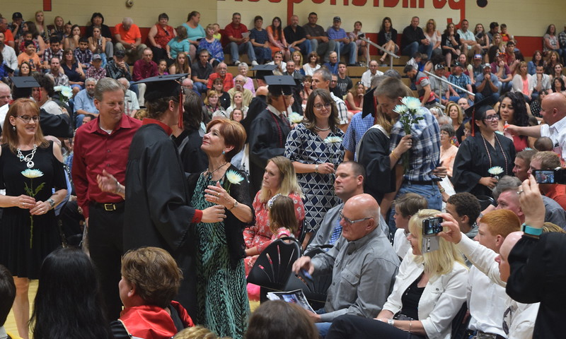 Graduates present followers to their family and friends during Haxtun High School's commencement ceremony Sunday, May 14, 2017.