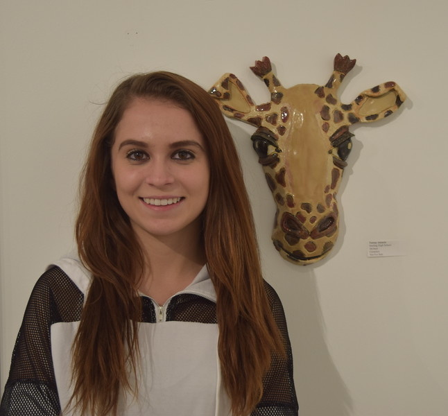 Sterling High School junior Tawny Atencio is pictured next to the ceramic giraffe, Melman, she entered into Northeastern Junior College's annual High Plains Secondary Art Exhibit.