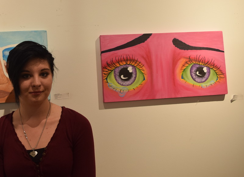 Sterling High School senior Emily Weiss is pictured next to one of two arylic on canvas paintings she displayed at Northeastern Junior College's annual High Plains Secondary School Art Exhibit.