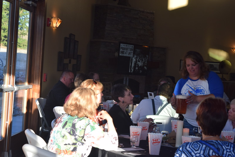 Kimberly Harford, owner of Parts & Labor Brewery, brings a pitcher of beer to a table to sample at Overland Trail Museum's History After Dark – Date Night at the Museum program Friday, June 23, 2017.