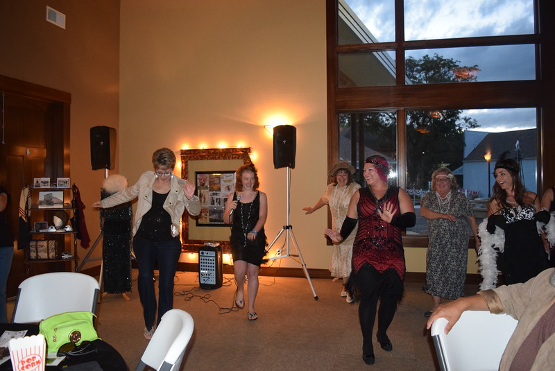 Leslie Fager, second from left, leads guests in dancing the Charleston at Overland Trail Museum's History After Dark – Date Night at the Museum program on the Roaring 1920s Friday, June 23, 2017.