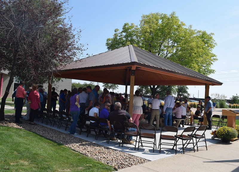 Guests mingle at the Janna Korrey Memorial Pavilion before the start of a dedication ceremony Sunday, Sept. 10, 2017.