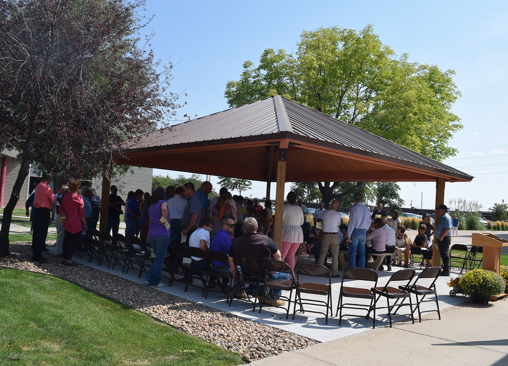 . Guests mingle at the Janna Korrey Memorial Pavilion before the start of a dedication ceremony Sunday, Sept. 10, 2017.