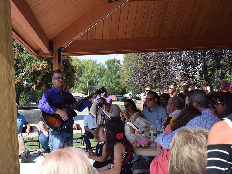 "Lee Lippstrew, assistant professor of music at Northeastern Junior College, leads the audience in singing one of Janna Korrey's favorite songs, ""You Are My Sunshine,"" during a dedication ceremony for the Janna Korrey Memorial Pavilion on Sunday, Sept. 10, 2017."