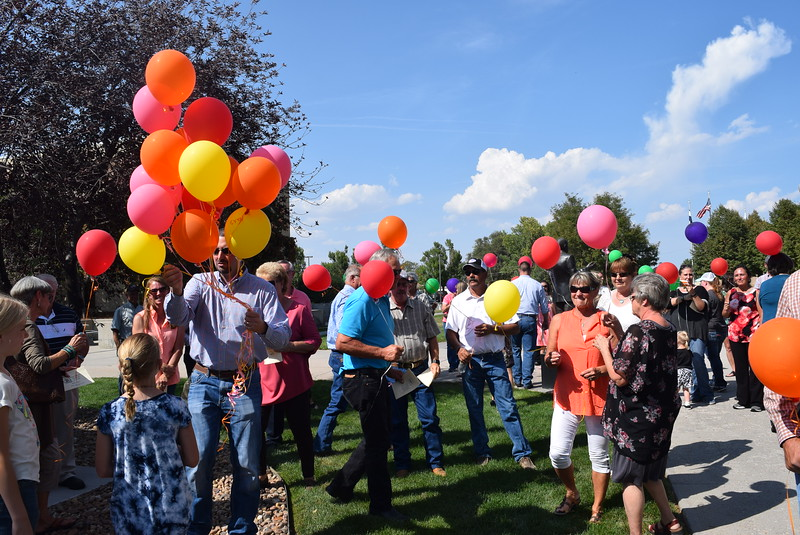Balloons are handed out for a balloon release in honor of Janna Korrey at the Janna Korrey Memorial Pavilion dedication ceremony Sunday, Sept. 10, 2017.