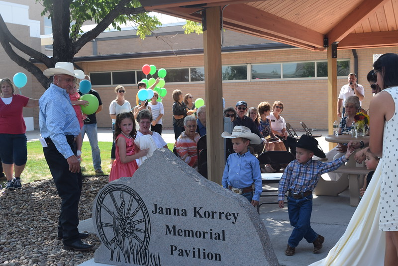 Janna Korrey's family unveils the memorial monument at the new Janna Korrey Memorial Pavilion on the Northeastern Junior College campus during a dedication ceremony Sunday, Sept. 10, 2017.