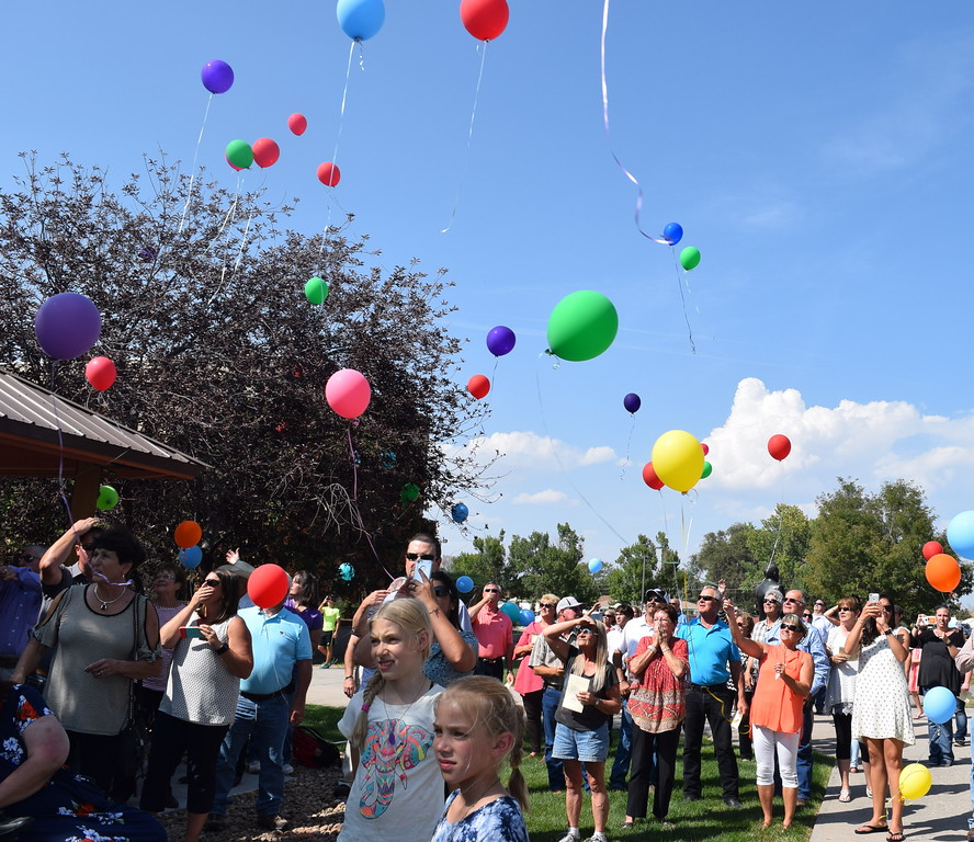 . Guests watch as balloons float away during a balloon release in honor of Janna Korrey at the Janna Korrey Memorial Pavilion dedication ceremony Sunday, Sept. 10, 2017.