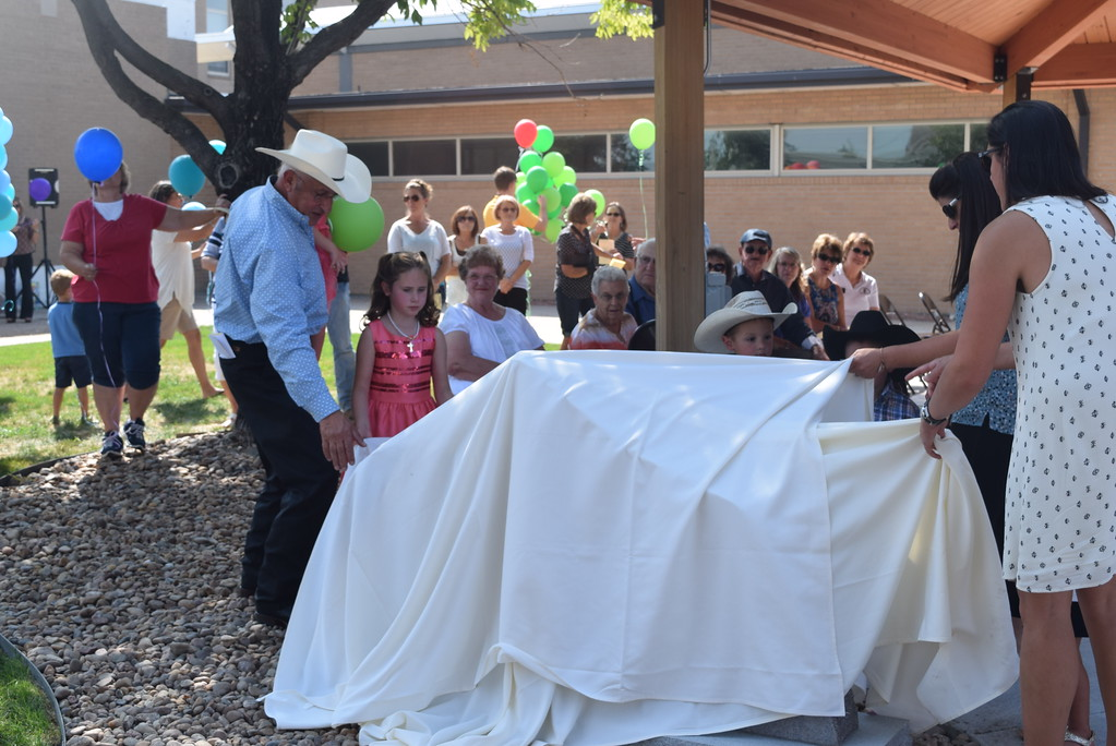 . Janna Korrey\'s family prepares to unveil a memorial monument at the Janna Korrey Memorial Pavilion during a dedication ceremony Sunday, Sept. 10, 2017.