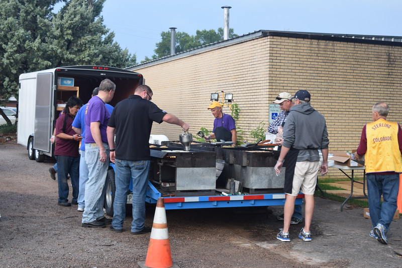 Members of the Sterling Lions Club were up bright and early Wednesday, Aug. 9, 2017, preparing pancakes, eggs and sausage for the Cowboy Breakfast, the traditional kick off to the Logan County Fair.