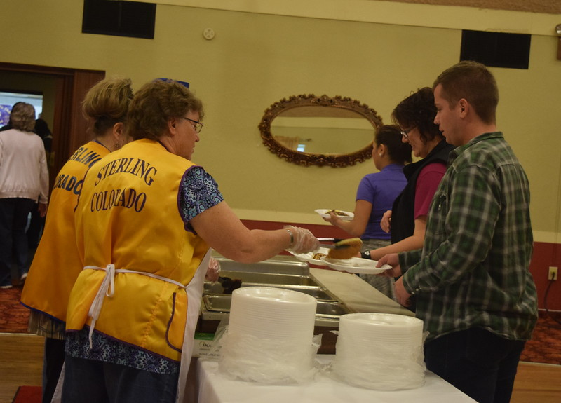 Sterling Lions Club members serve up pancakes, eggs and sausage to guests at the Cowboy Breakfast Wednesday, Aug. 9, 2017.