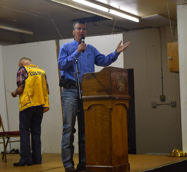 Logan County Fair Manager Todd Thomas encourages people to attend the various events at the fair during the Cowboy Breakfast Wednesday, Aug. 9, 2017.