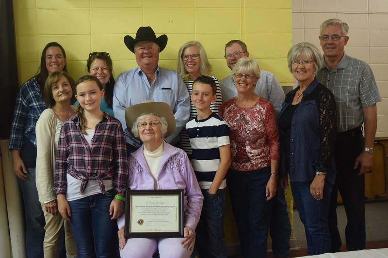 Jenevieve Sanders Manuello De Soto, one of the recipients of the Sterling Lions Club's Pioneer Awards at the Cowboy Breakfast Wednesday, Aug. 9, 2017, poses for a photo with her family.