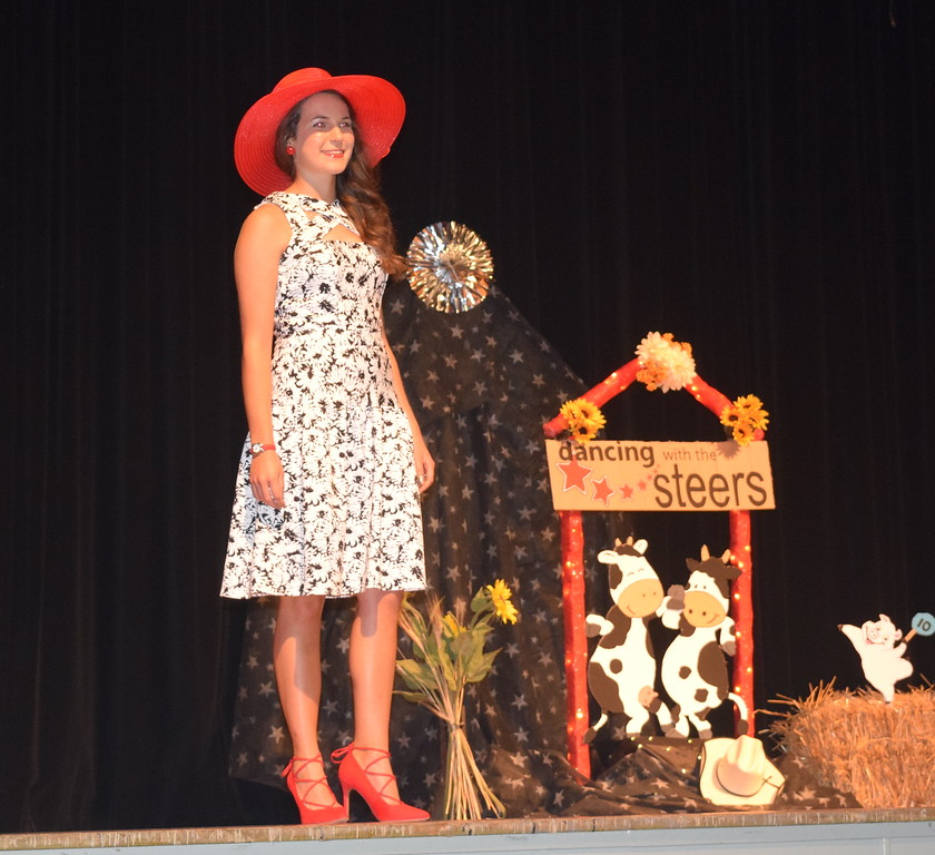 Rachael Northup models her outfit in the encore division of the Logan County Fair 4-H Fashion Revue Friday, Aug. 4, 2017.
