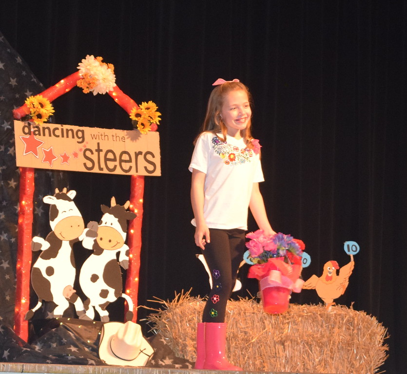 Ayla Baney models her outfit in the junior division of the Logan County Fair 4-H Fashion Revue Friday, Aug. 4, 2017.
