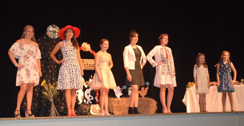 Participants in the encore division of the Logan County 4-H Fashion Revue Friday, Aug. 4, 2017, pose for a photos. From left; Kayleigh Mackintosh, Rachael Northup, Aly Young, Shelby Houser, Kathryn Lock, Ayla Baney and Ashton Nichols.